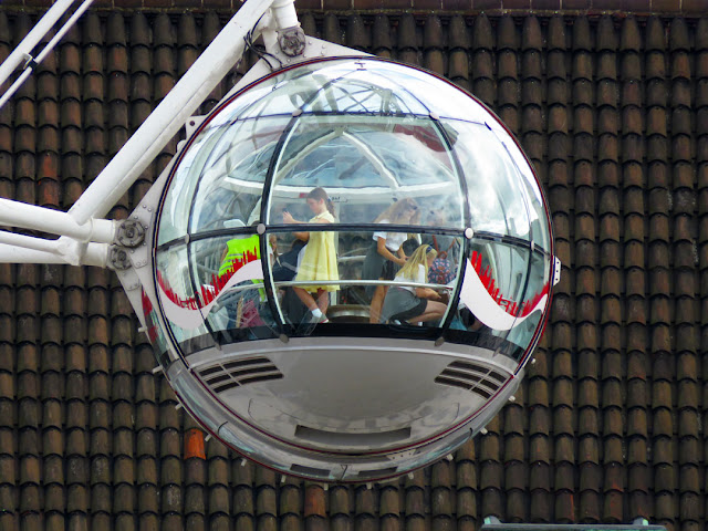 London Eye capsule with passengers, The Queen's Walk, South Bank, Lambeth, London