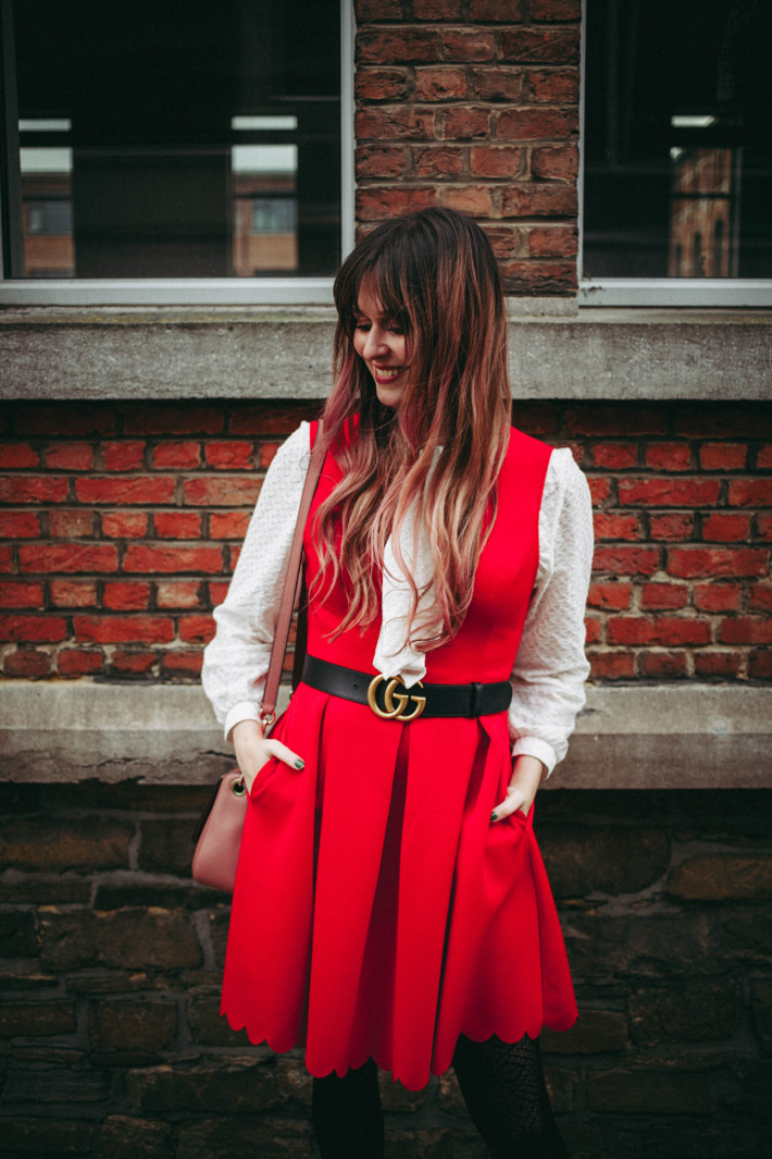 Outfit: red pinafore, white pussybow blouse, gucci belt