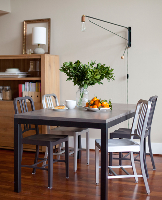 swing arm wall lamp for the dining table image via apartment 34. Black Bedroom Furniture Sets. Home Design Ideas
