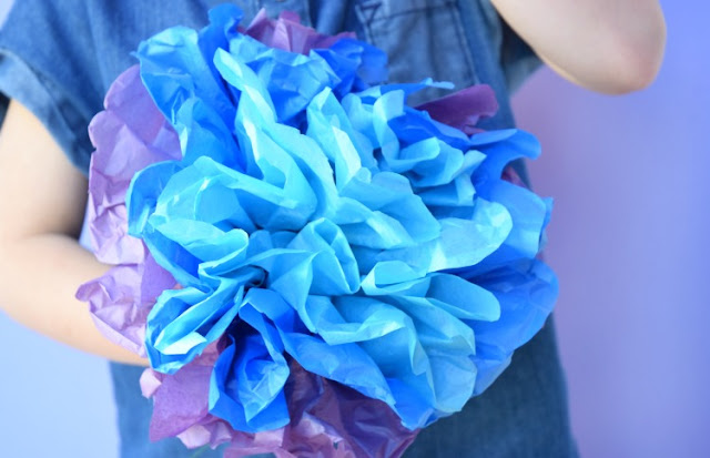 Tissue Paper Flowers- Classic Kids Craft.  Perfect spring or summer project for preschoolers, kindergartners, or elementary children.  Make a whole colorful flower bouquet!