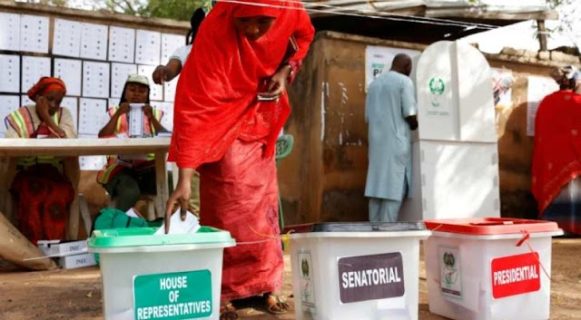 Nigerians await winner of presidential vote after polling problems
