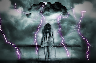 blog picture of young girl sitting head down with a storm behind her