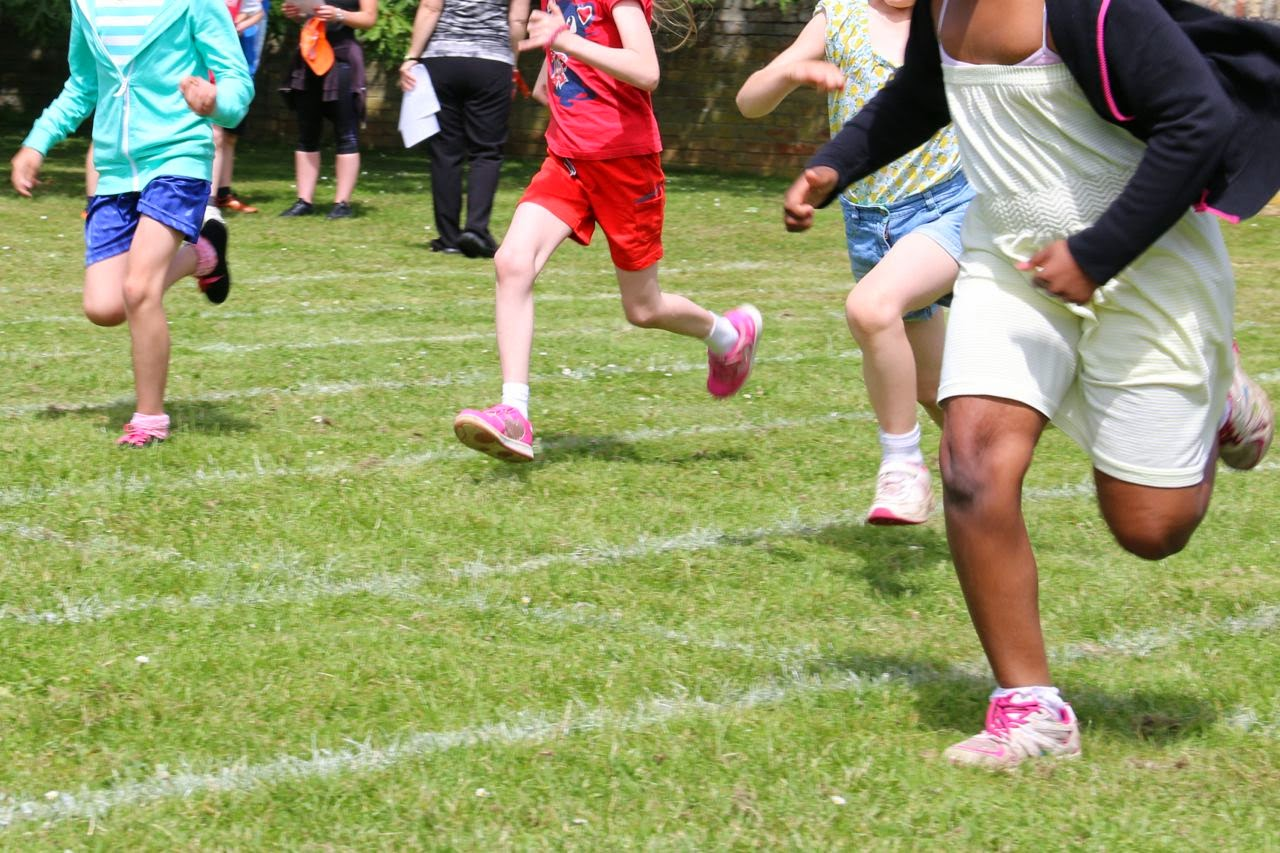 Children running a race on sports day