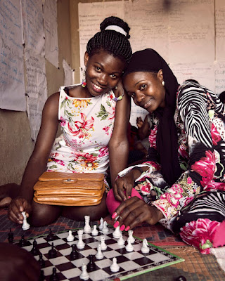 Friends playing chess in Kampala the capital and largest city of Uganda.