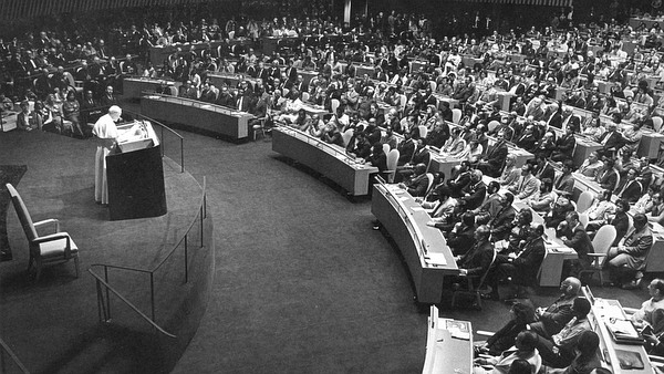A black and white photo of St. John Paul II giving his address to the UN in 1979.