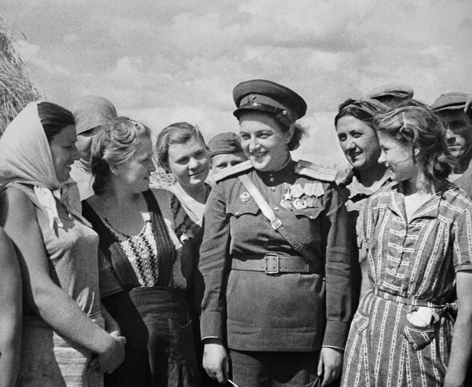 Pavlichenko visits workers near Odessa. 1944.