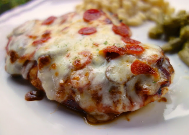 Pizza Smothered Chicken - your two favorite foods in one easy dinner! Italian marinated chicken pan seared, topped with pizza sauce, mozzarella and pizza toppings. Only 5 ingredients!! SO good! Everyone gobbled this up!! A new easy weeknight favorite!