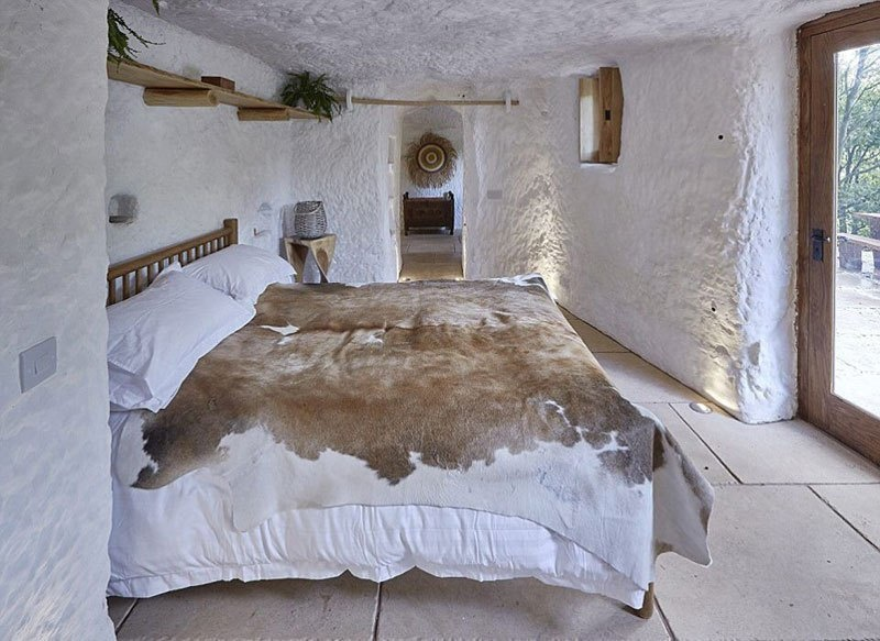 He's spent over 1,000 hours cutting and burrowing the rock, creating an amazing space inside. - He Turned A 700 Year-Old Cave Into A Dream Home… Wait Till You See The Kitchen.