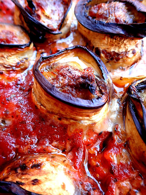 Meatballs wrapped in aubergine in rich tomato sauce. The idea for a delicious dinner. Tips how to avoid putting too much oil into aubergine.