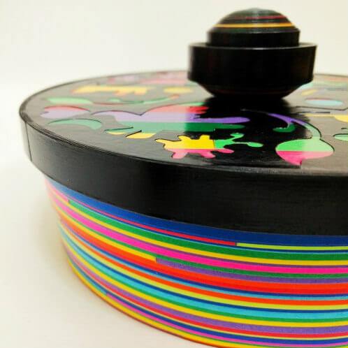colorful rolled paper container with lid