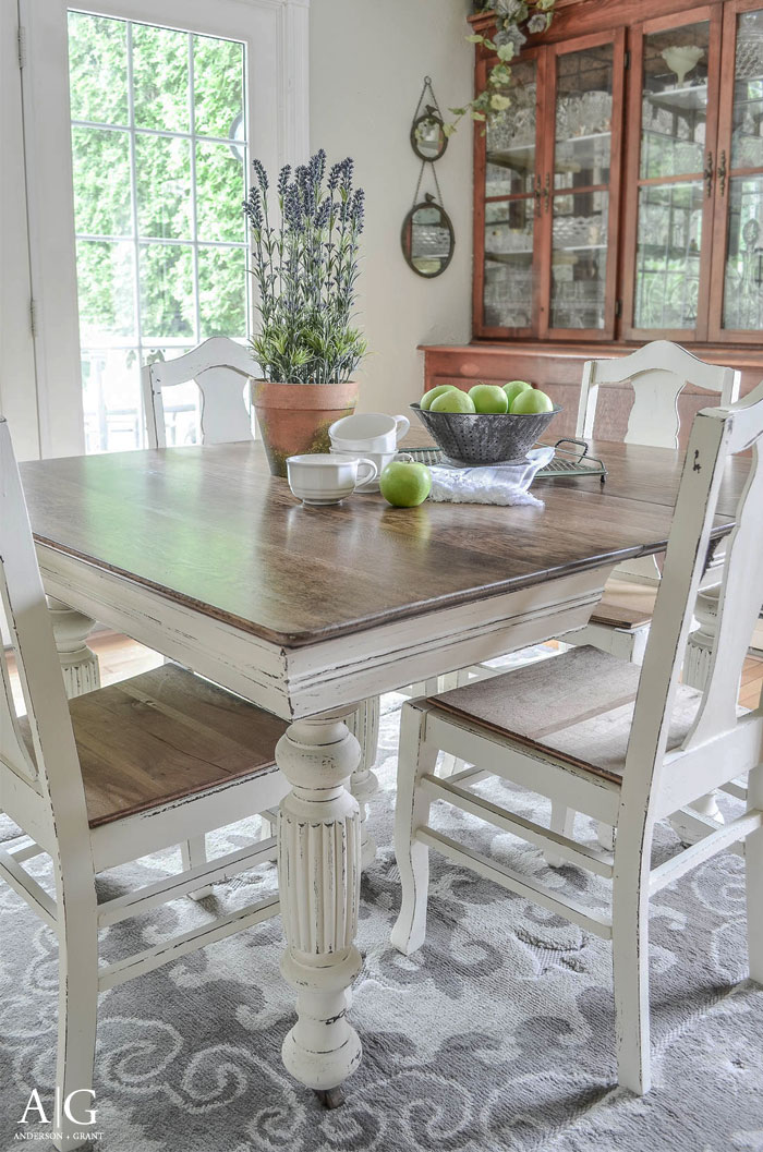 The contrast between the wood top and painted legs of this dining table is beautiful.  See the before and after at www.andersonandgrant.com