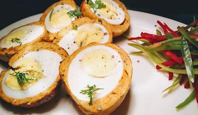 Scotch Egg  cut into half and garnished for scotch eggs recipe