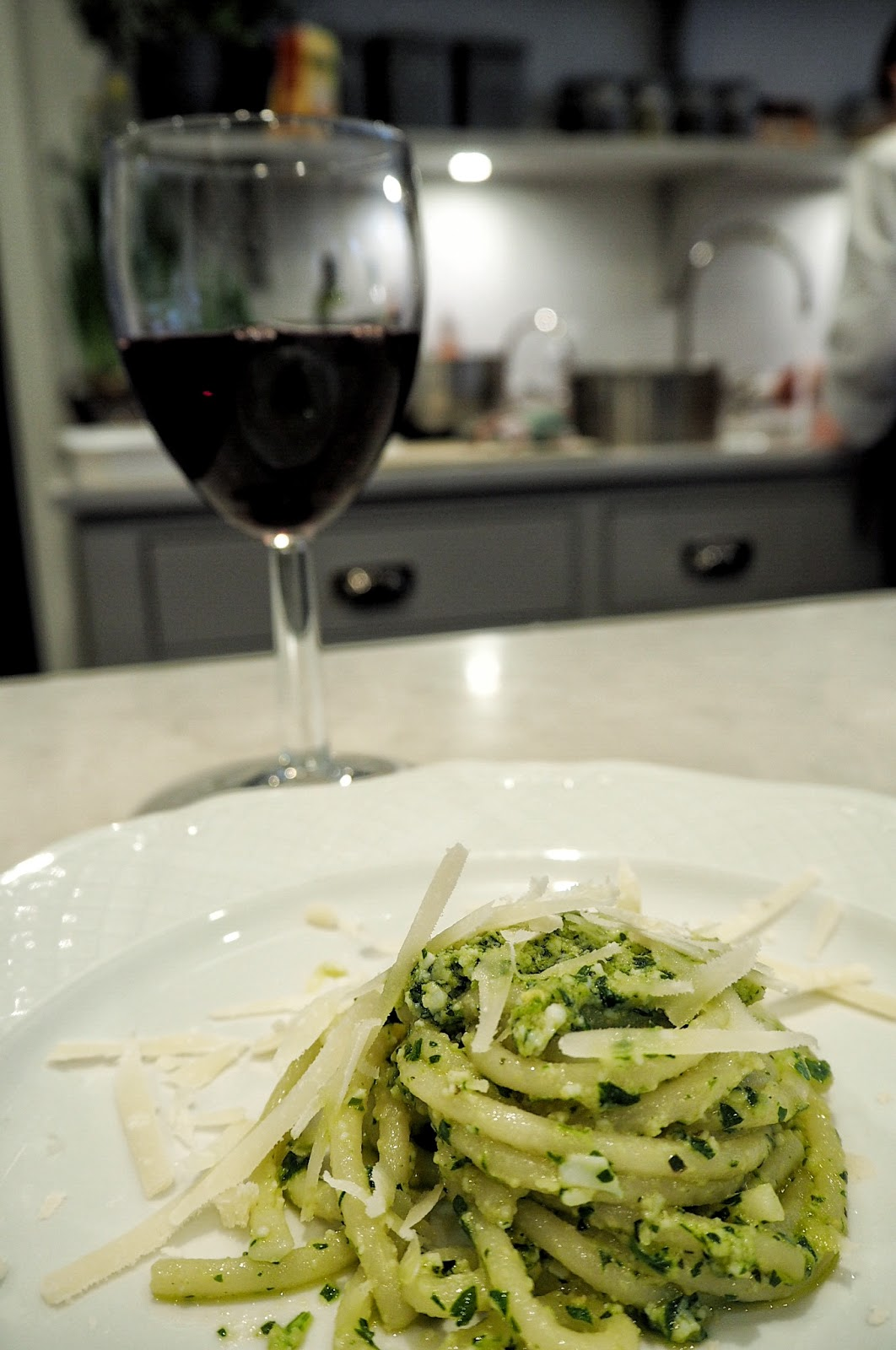 Italian Pici Pesto Dish with red wine