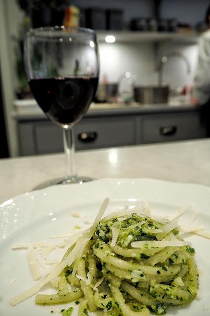 Italian Pici Pesto Dish with red wine