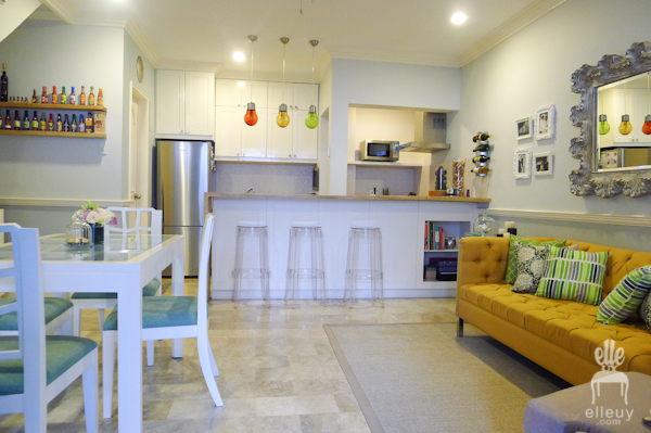 beach costal chic small townhouse living dining kitchen with yellow sofa and gray walls