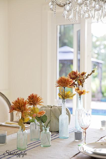 elegant thanksgiving table with vintage bottles