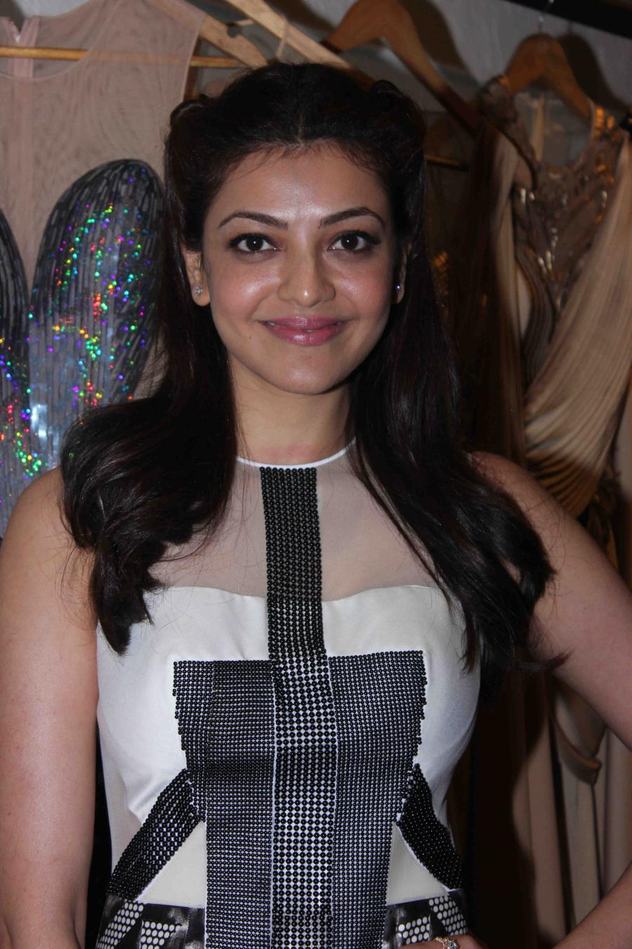Kajal Aggarwal Smiling Stills In Gorgeous Black Designer Dress