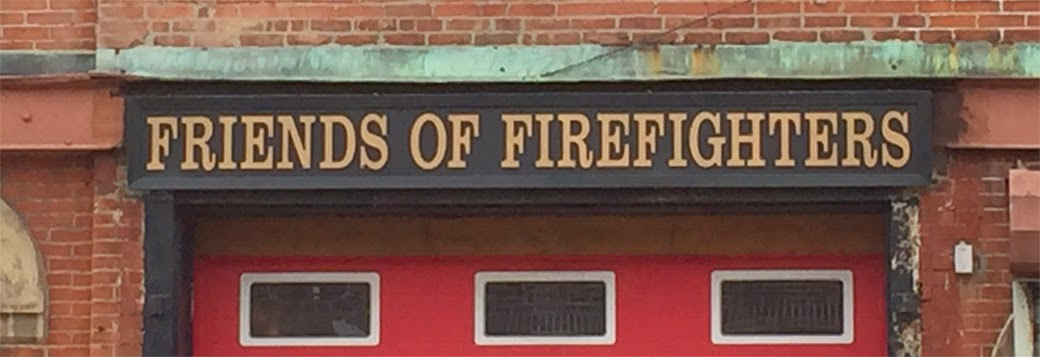 Friends of Firefighters sign over roll door