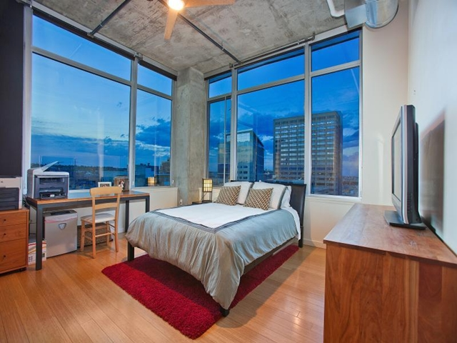 Kids room in Denver penthouse with working table and incredible views of the city