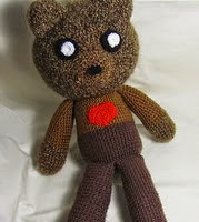 http://www.ravelry.com/patterns/library/john-bear-amigurumi