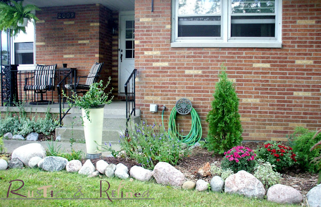 Garden Flower beds on a budget. Adding curb appeal with a little patience and a lot of hard work.