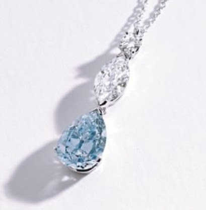 Fancy Intense Blue Diamond & Near COlorless Diamond Pendant Necklace sold at Sothebys