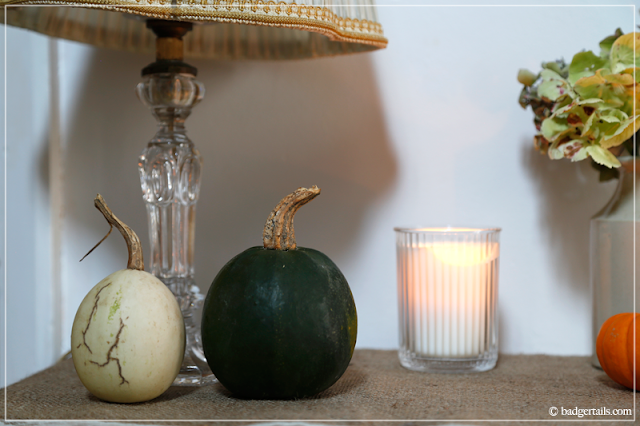 Green and White Pumpkins with Candles in Fall Decor