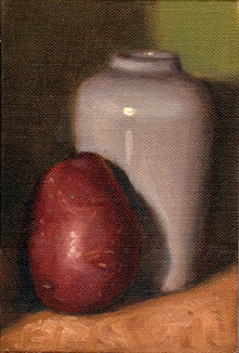Oil painting of a red-skinned potato beside a white porcelain vase.