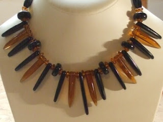 Amber and black plastic necklace