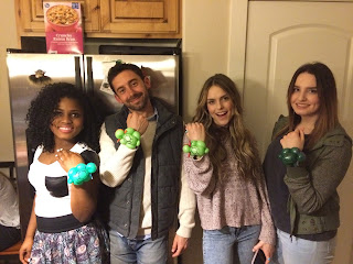 A Group of Young Adults Posing with their Ninja Turtle Balloon Bracelets.