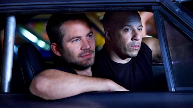 Brian O'Conner şi Dominic Toretto în filmul Fast Five