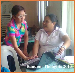 Div. planning officer assisting ICT teacher on encoding