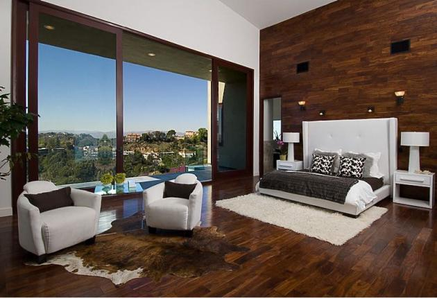 Picture of modern bedroom with dark wooden floor and one wall