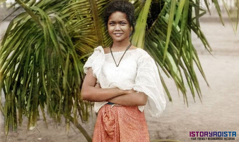 Filipino girl by the palm tree (c1900s)