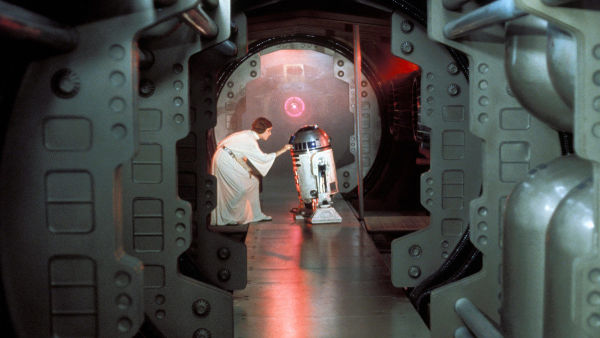 Princess Leia giving R2-D2 the stolen Death Star plans