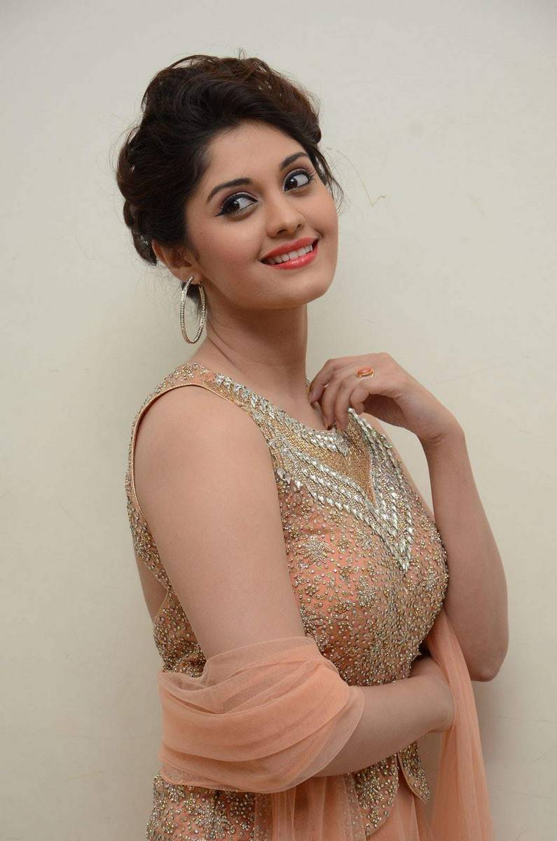Surabhi Hot Photos In Pink Dress At Audio Launch