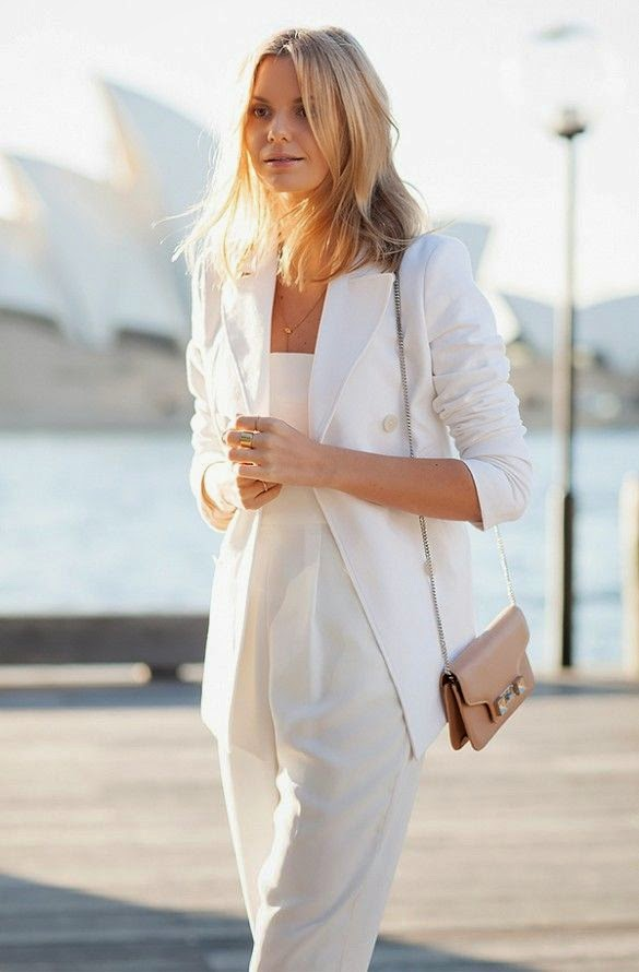 Wearing a White blazer and Jumpsuit with Nude Mini Bag