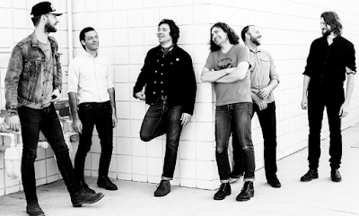 """Lirik Lagu The War On Drugs - Holding On"""