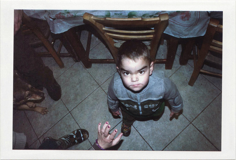 dirty photos - upon - flash street photo of angry little boy looking up in taverna