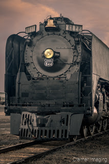Cramer Imaging's fine art photograph of the Union Pacific 844 Steam Engine on a train track at sunset