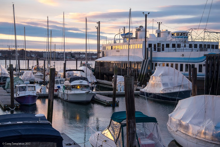 Portland, Maine USA January 2017 photo by Corey Templeton of quiet winter morning on Long Wharf DiMillo's Marina boats in Casco Bay.