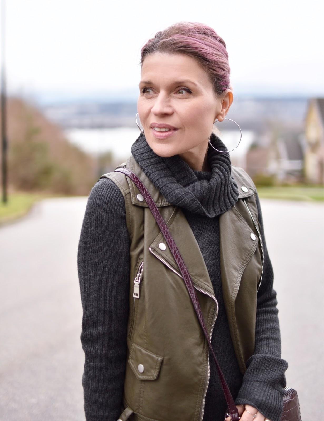 Monika Faulkner outfit inspiration - turtleneck sweater dress, motorcyle vest
