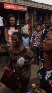 Female kidnapper stripped naked in Lagos for hypnotizing a girl