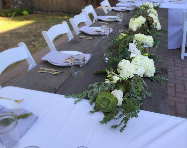 Floral table runner with white flowers and succulents