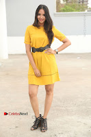 Actress Poojitha Stills in Yellow Short Dress at Darshakudu Movie Teaser Launch .COM 0031.JPG