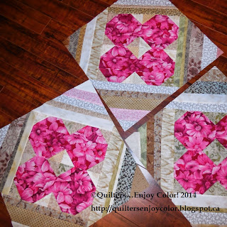 http://quiltersenjoycolor.blogspot.ca/2014/06/wildflower-improvise.html