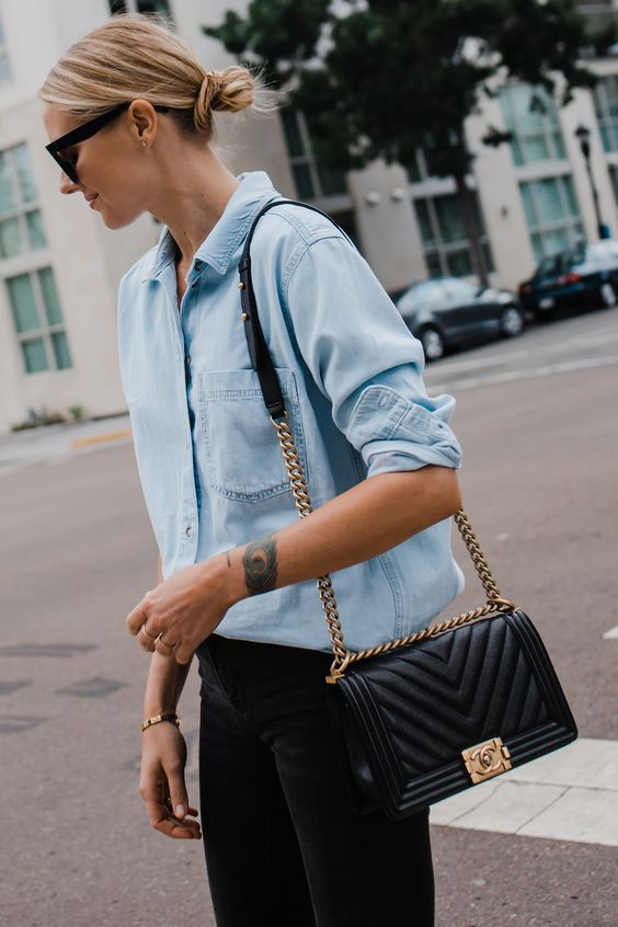 Blond woman with Chanel quilted bag Fashionjackson.com