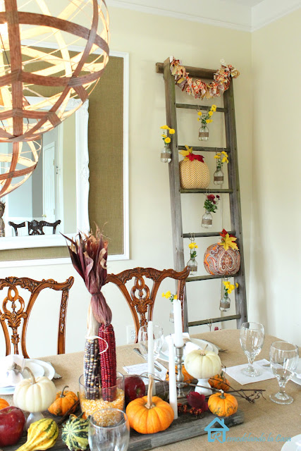 a formal dining set is dressed in a rustic way for Thanksgiving