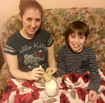 Boy and Girl Dunking Biscuits in Milk