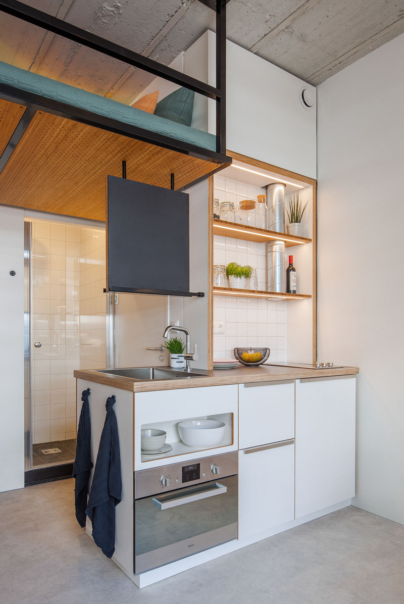 small-apartment-design-kitchen-110518-1146-04 This Contemporary Small Renovation Apartment Has A Loft Bed Suspended From The Ceiling Interior